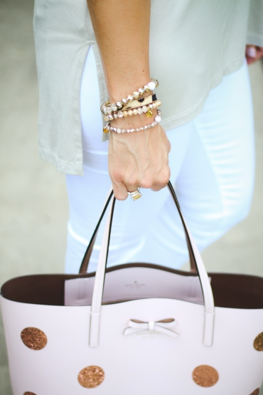 hand with bag and bracelets